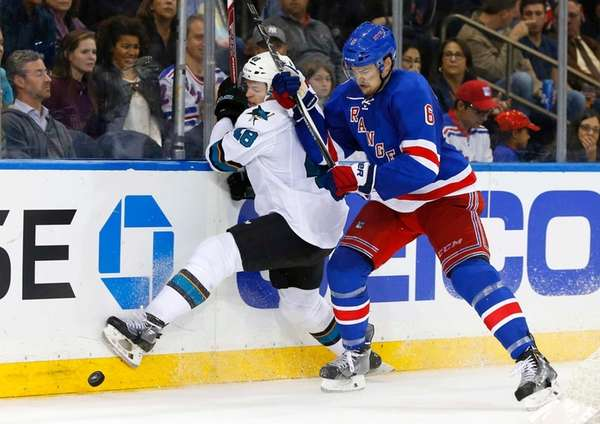 Dylan McIlrath of the New York Rangers checks