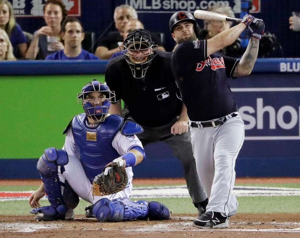 Cleveland Indians' Mike Napoli, right, watches his home