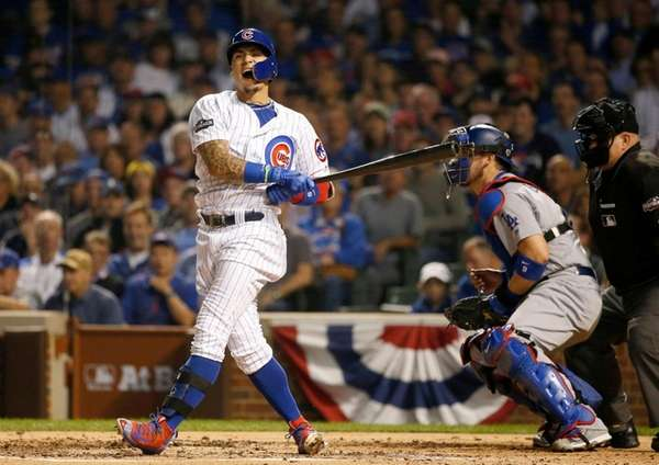 Chicago Cubs second baseman Javier Baez reacts after