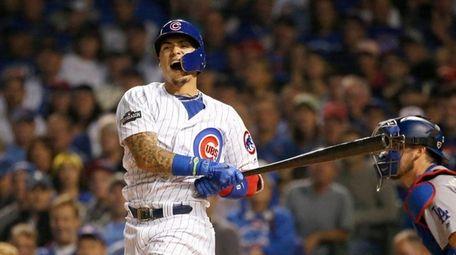 Chicago Cubs second baseman Javier Baez reacts after