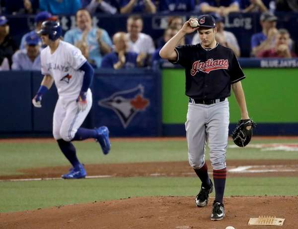 Cleveland Indians starting pitcher Trevor Bauer, right, walks