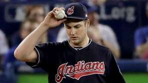 Cleveland Indians starting pitcher Trevor Bauer, right, walks