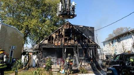 Volunteer firefighters battle a house fire at 24