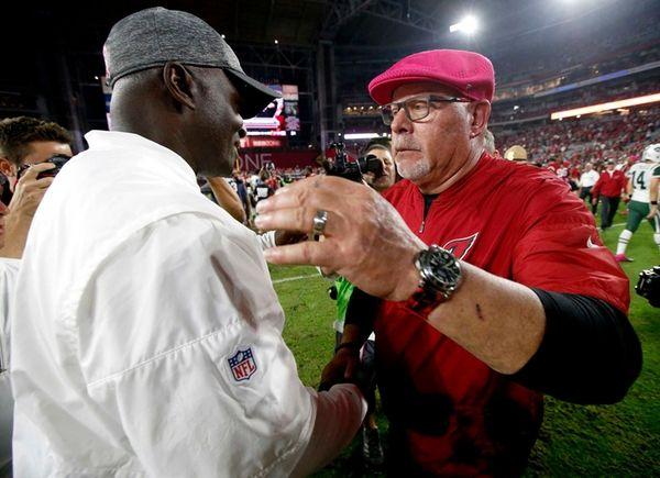 Arizona Cardinals head coach Bruce Arians, right, greets