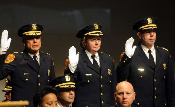 Deputy Chief JoAnn McLaughlin, center, was among those