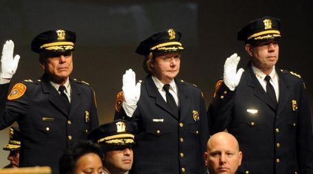Deputy Chief JoAnn McLaughlin, center, was among those