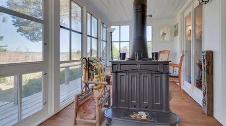 The enclosed porch on this two-bedroom house in