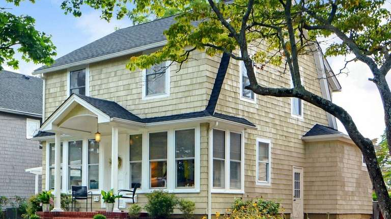 This Babylon Colonial With An Enclosed Porch Is