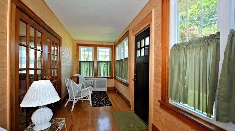This Rockville Centre Colonial has an enclosed porch.