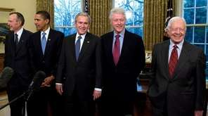 U.S. President George W. Bush (C) meets with