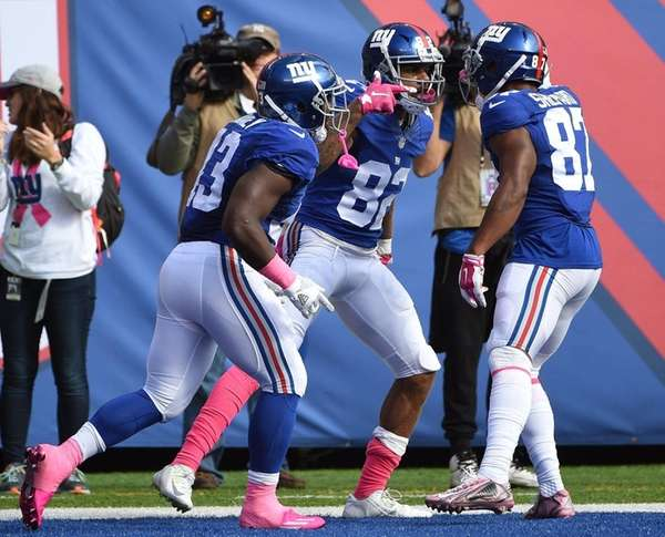 New York Giants wide receiver Roger Lewis, center,