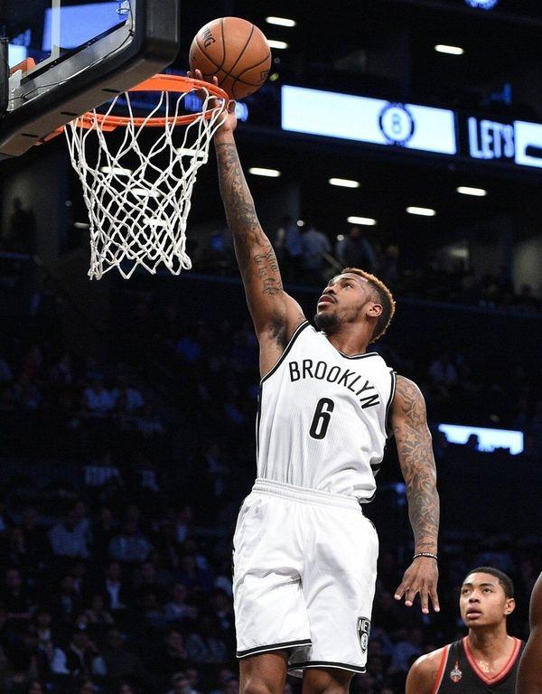 Brooklyn Nets guard Sean Kilpatrick sinks a layup