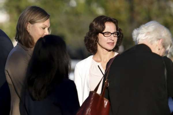 Sabrina Erdely, center, enters the federal courthouse in