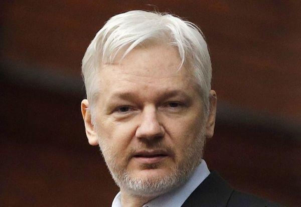 WikiLeaks founder Julian Assange stands on the balcony