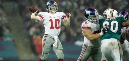 New York Giants' Eli Manning passes against the