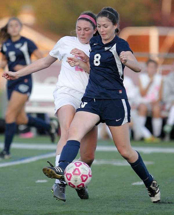 Whitman's Meghan Soulias (23) and Northport's Emily McNelis