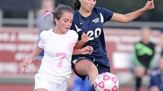 Whitman's Gianna LeMay (7) and Northport's Emily Cerrito