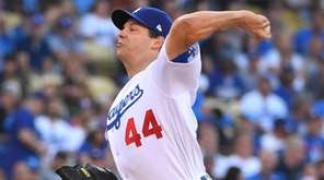 Los Angeles Dodgers starting pitcher Rich Hill throws