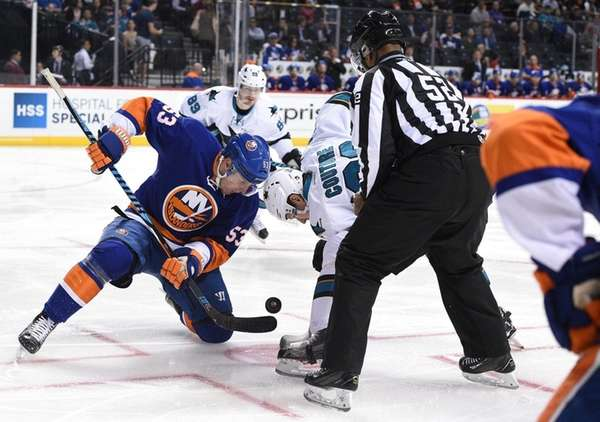 New York Islanders center Casey Cizikas faces off