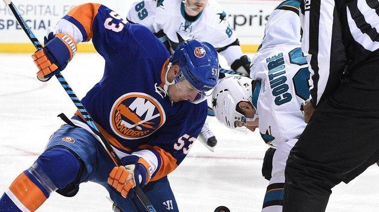 New York Islanders center Casey Cizikas faces off