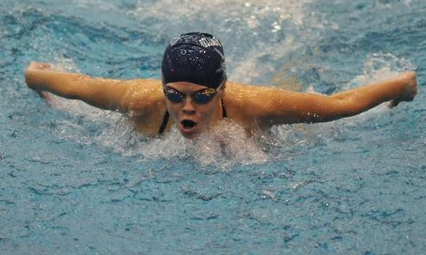 Hazel Wilkins of Bellmore-Merrick swims in the 100