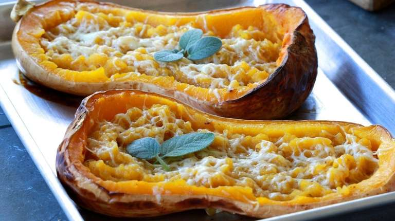 Halved butternut squash is roasted, scooped out, mashed,