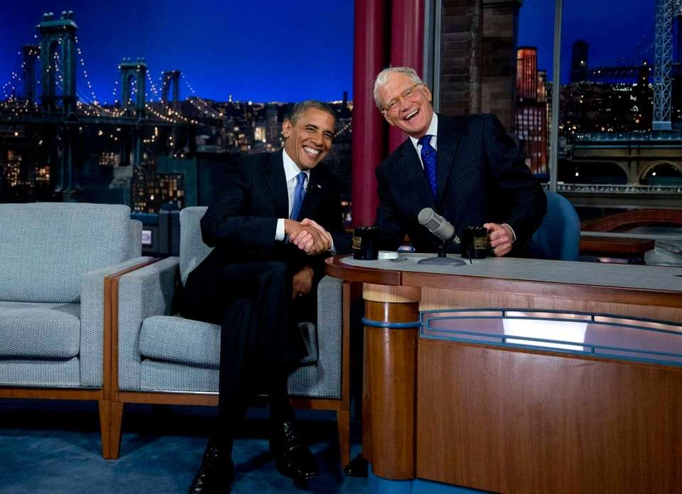 President Barack Obama talks on the set of