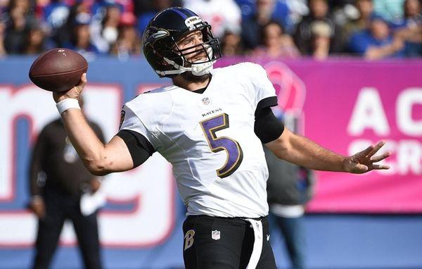 Baltimore Ravens quarterback Joe Flacco passes the ball