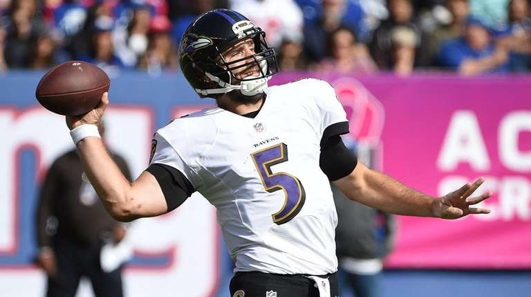Baltimore Ravens quarterback Joe Flacco passes the ball
