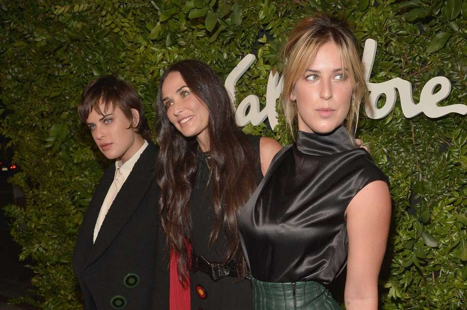 Actress Demi Moore, center, attends a Ferragamo party