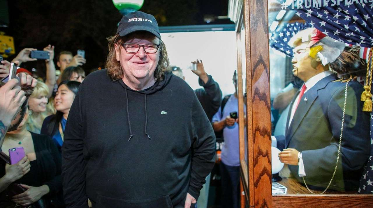 Director Michael Moore attends the Manhattan premiere of