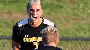 Commack's Scott Cebollero (7) celebrates a score with