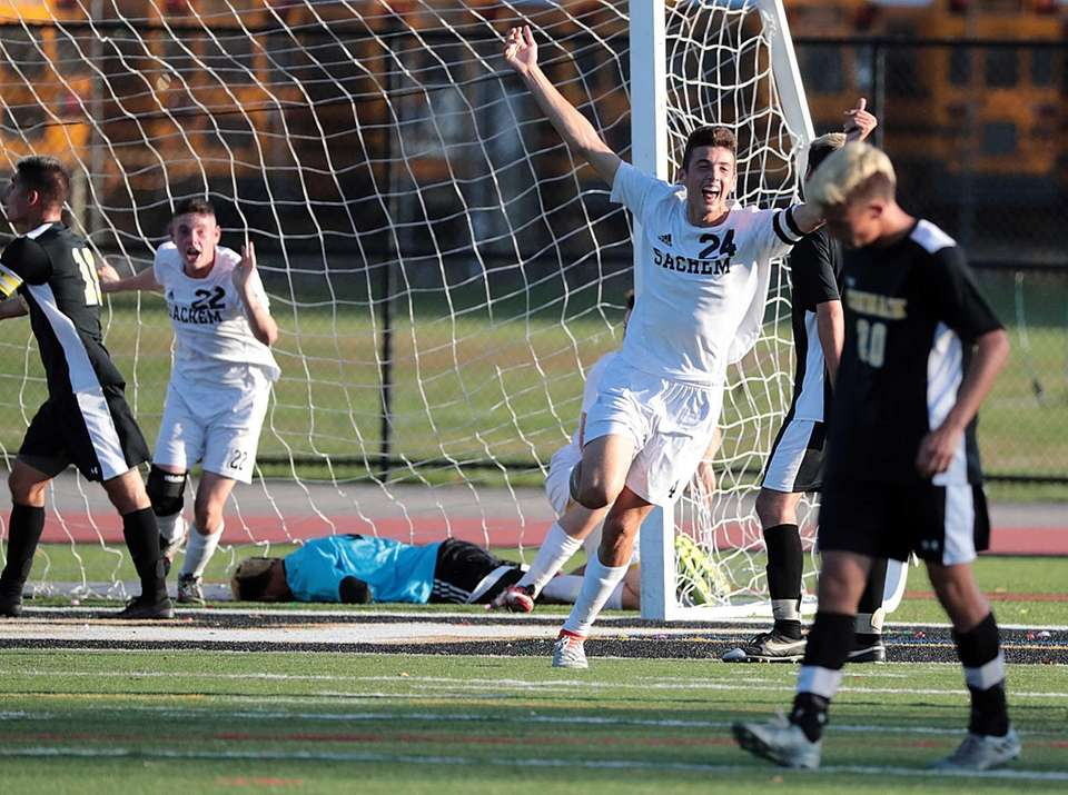 Sachem North's Kevin Churns (22) and Drew Scally
