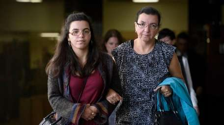 Rosemary Hernandez, right, the wife of Pedro Hernandez's