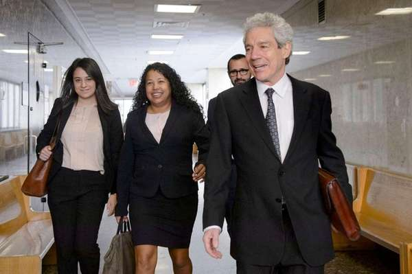Defense attorney Harvey Fishbein, right, and his associate