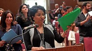 Niketa Bhatia of Woodbury presents a petition to