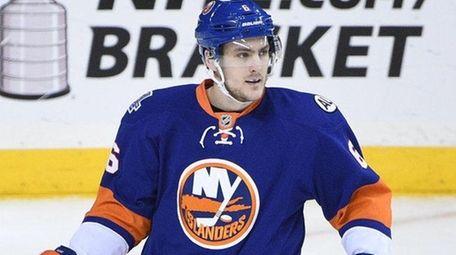 New York Islanders' defenseman Ryan Pulock looks on