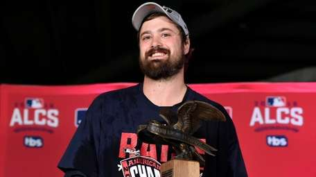 Cleveland Indians' relief pitcher Andrew Miller accepts the