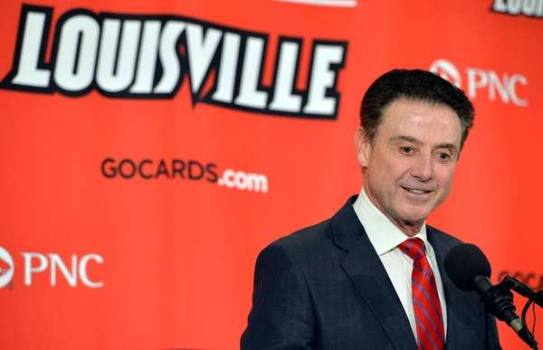 Louisville head basketball coach Rick Pitino answers questions