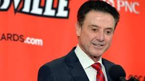 Louisville head basketball coach Rick Pitino answers questions