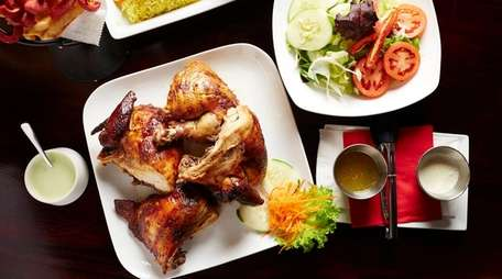 Juicy, Peruvian-style rotisserie chicken feeds at least two