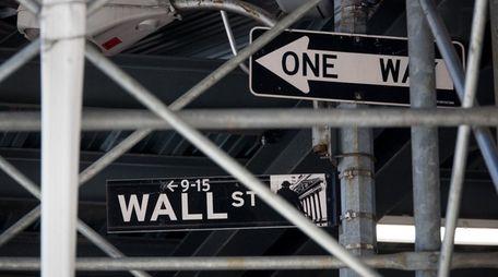 Street signs under scaffolding near the New York