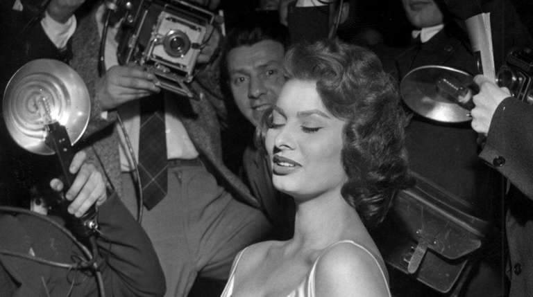 Actress Sophia Loren poses for the photographers at