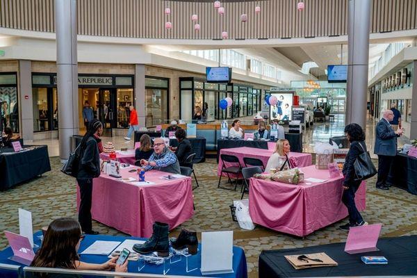 Job seekers meet with mall vendor representatives during
