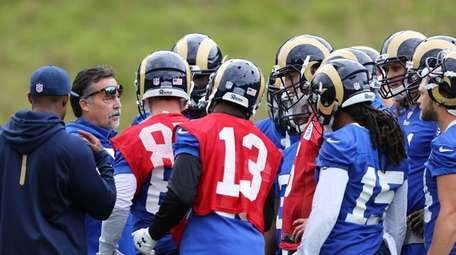 LA Rams head coach Jeff Fisher, second left,