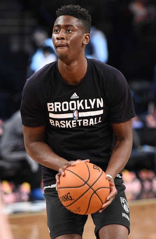 Brooklyn Nets guard Caris LeVert warms up before