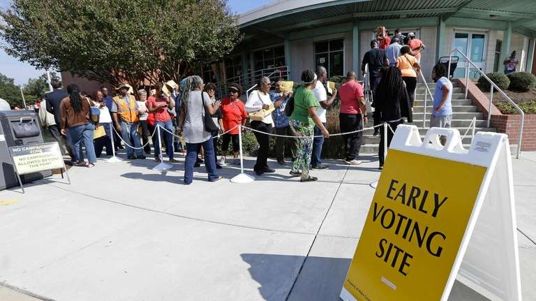 Voters line up Thursday, Oct. 20, 2016, during