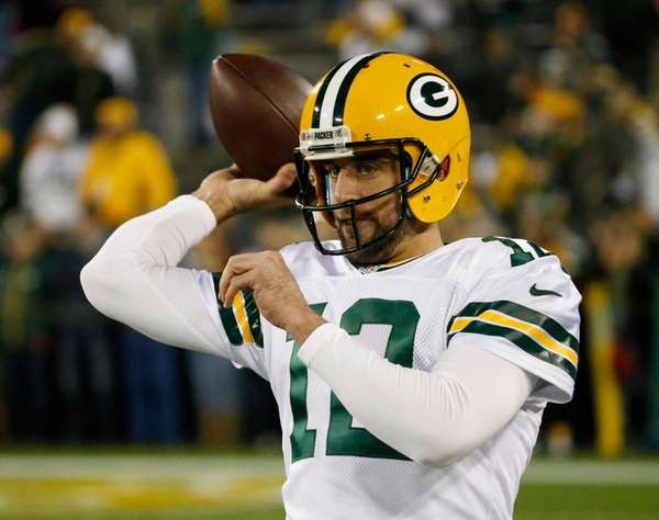 Green Bay Packers quarterback Aaron Rodgers (12) warms