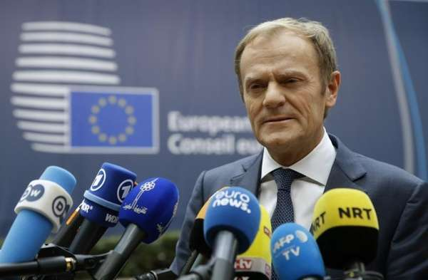 European Union Council President Donald Tusk speaks to