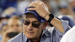 Actor Charlie Sheen reacts during the fifth inning